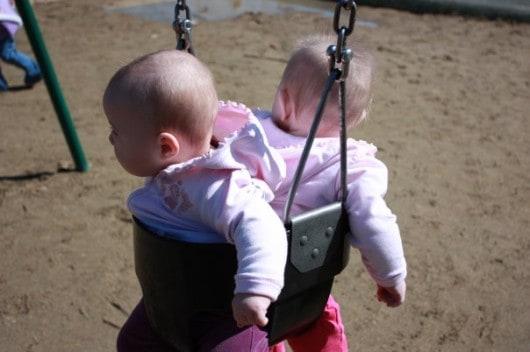 Twin Babies on a swing