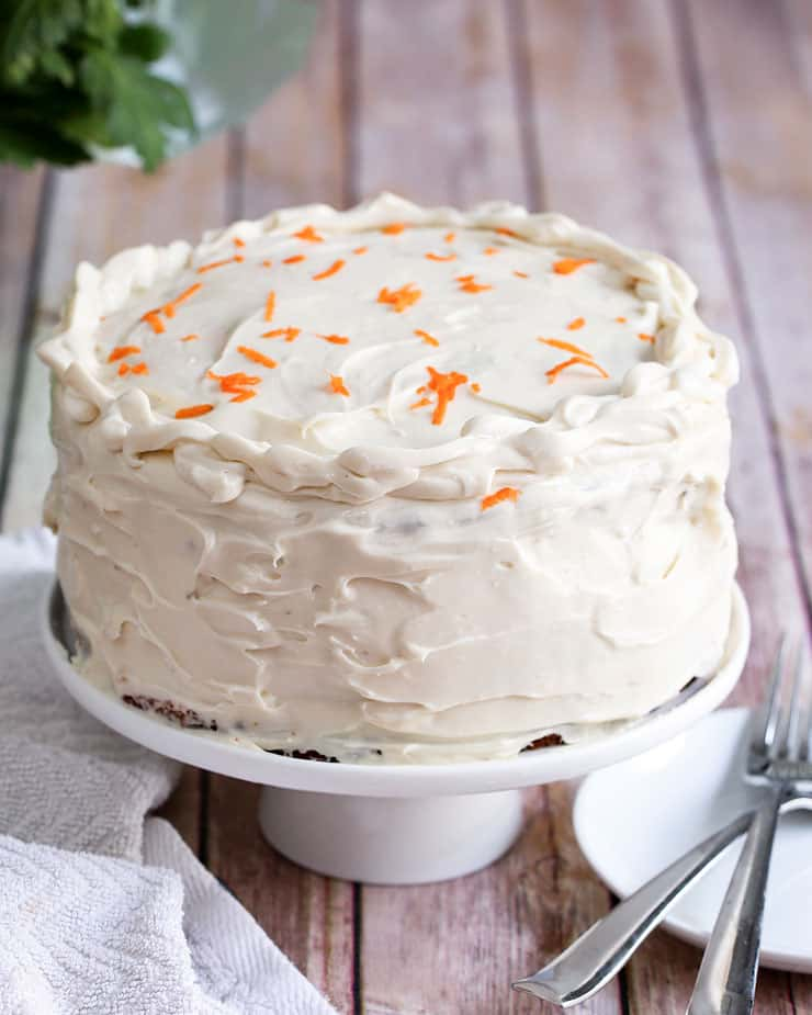 This easy Carrot Cake Recipe is moist and delicious, and has the perfect cream cheese icing ever. This cake is guaranteed to become one of your go-to dessert recipe for all occasions.