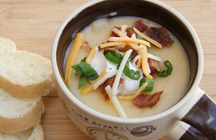 Slow Cooker Loaded Baked Potato Soup tastes just like a loaded baked potato - very rich, think and creamy. Heaven with each spoonful!
