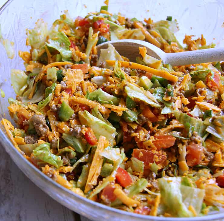 This Taco Salad recipe is my go-to when I want a quick and easy meal. I love the spices and crunch! Plus, it's a hit for dinners and a potluck salad!
