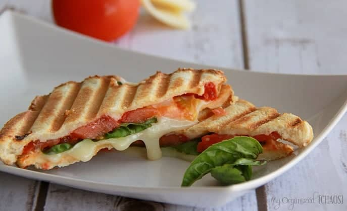 Margherita Panini Sandwich recipe, panini bread, mozza cheese, fresh tomato, basil leaves, olive oil - lunch idea and great with soup - comfort food! #panini #sandwichrecipe