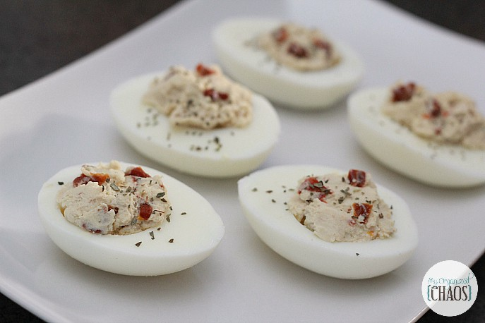 California-Style Devilled Eggs. A recipe that includes sun-dried tomatoes, basil, balsamic vinegar. Perfect appetizer!