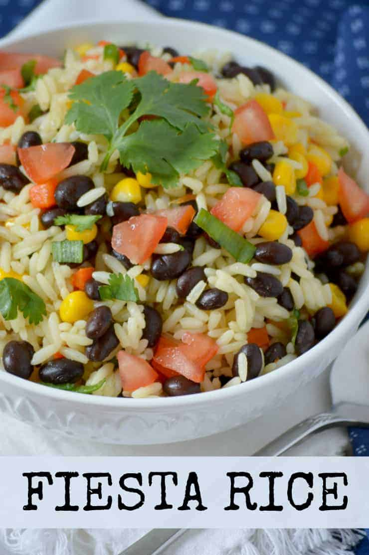 This Fiesta Rice recipe is a Mexican rice side dish with jasmine, tomatoes, corn, cilantro, lime and black beans. Full of flavour and so easy to make!