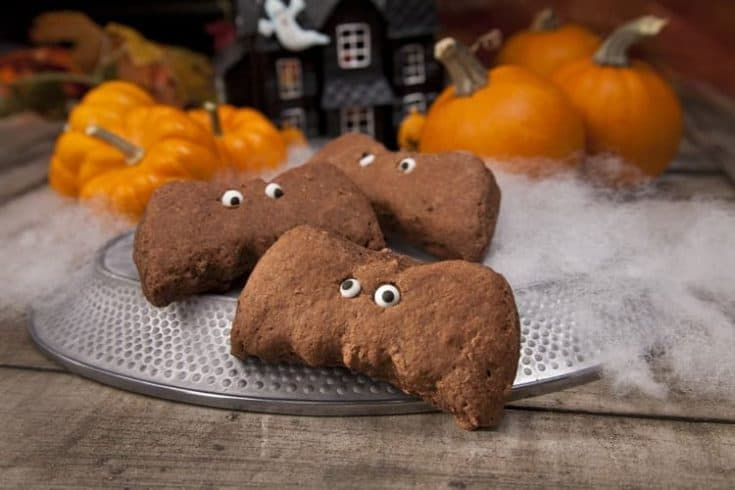 A quick Halloween-themed treat ready in just 10 minutes. Try these delicious Chocolate Bat Biscuits made with Almond Breeze! #halloween #halloweencookies