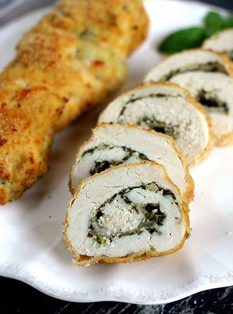 Pesto Cheese Stuffed Chicken Rolls with mozzarella and a delicious nut-free pesto. This recipe for chicken breasts is one you just have to try!