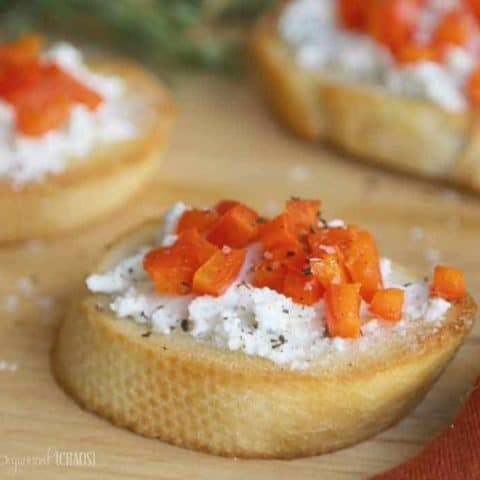 This Crusty Herbed Crostini Appetizer recipe is a crusty baguette, comforting goat cheese & a blend of herbs and red pepper - perfection!