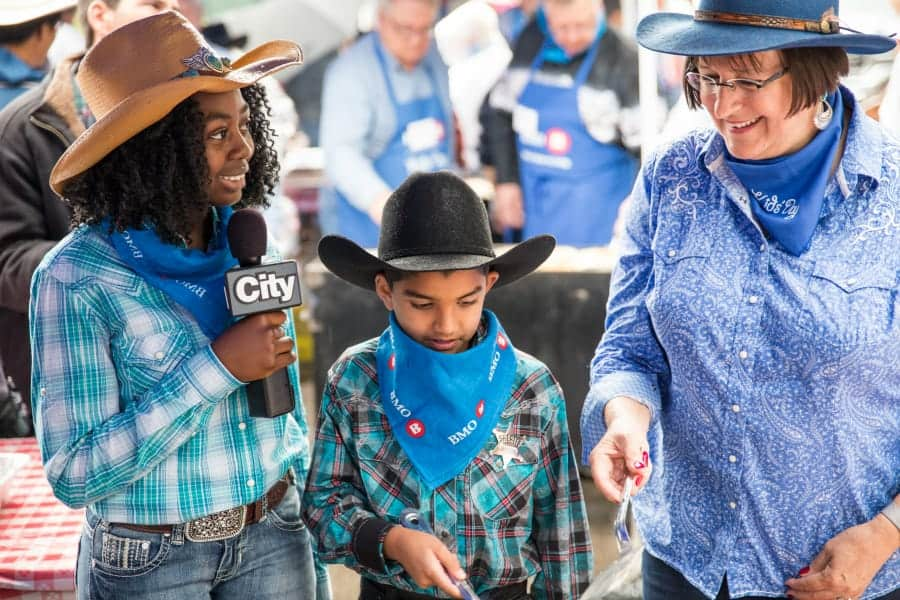 How to Take in the Calgary Stampede with Kids on a Budget