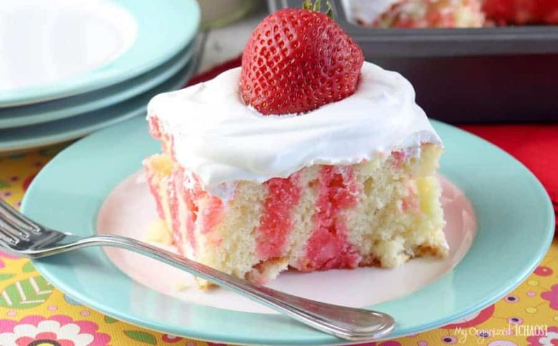 This Strawberry Jello Poke Cake is cool and light - and the sweetness comes from the berries. Plus, it's a very simple recipe, one made with a box cake mix.