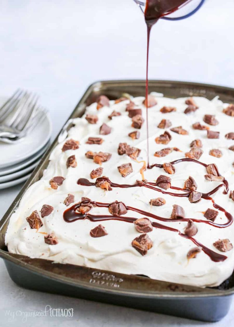 This Rolo Poke Cake is a delicious chocolate and carmel taste explosion with caramel sauce and a chocolate drizzle.