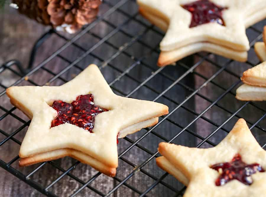 You can be the of the holiday party or baking exchange with these Star-Shaped Jam Cookies. They are so festive, fun and elegant to make as a holiday treat.