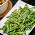 These Roasted Parmesan Green Beans are the most delicious way to enjoy fresh green beans. This simple vegetable recipe makes a great side dish to any meal!