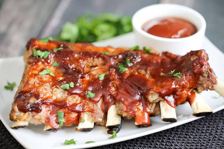 Tender BBQ ribs are finger lickin' good thanks to this super-easy and no-fuss Instant Pot BBQ Ribs recipe. With a spice rub and BBQ sauce broil, this classic comfort food can be on your table in 40 minutes. You'll love this mouthwatering recipe!