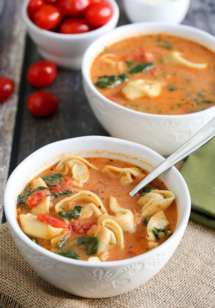 This Instant Pot Tomato Tortellini Soup recipe is creamy and delicious with spinach, chicken and a blend of perfect spices. It's a filling soup perfect for lunch or dinner, or simply when the craving for a comforting soup hits!