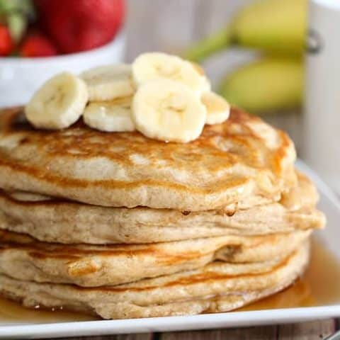 This is the best Whole Wheat Pancakes recipe! This delicious and fluffy pancake recipe has hints of irresistible vanilla and cinnamon and is a healthy option since it uses whole wheat flour. You'll never make regular pancakes again!