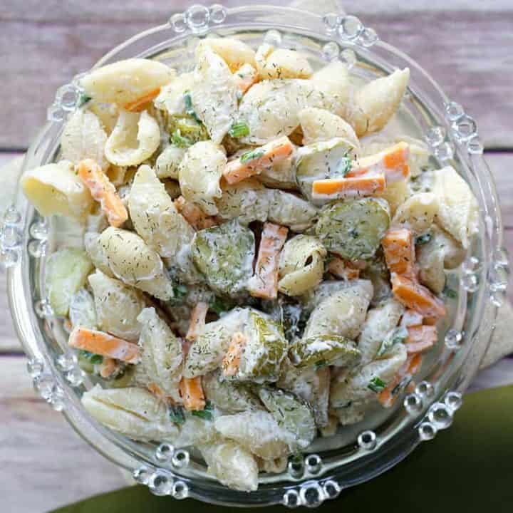 Calling all dill pickle lovers, this salad recipe is for you! This creamy Dill Pickle Pasta Salad is THE BEST and has the tangy flavour of crunchy pickles, fresh dill, cheese, mayo and sour cream. It's the perfect side for any BBQ or summer meal.