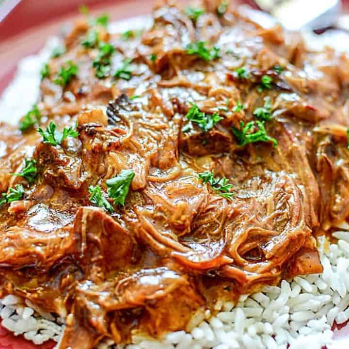 This easy 6-ingredient recipe for Slow Cooker Cherry Coke BBQ Pulled Pork has that smoky BBQ and sweet cola flavour that makes for a tender, juicy, and flavourful pulled pork.