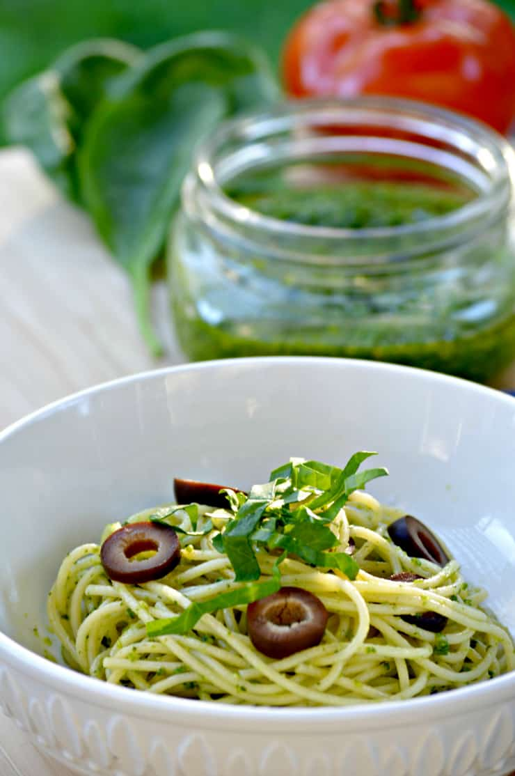 This easy homemade 5 minute pesto recipe tastes absolutely delicious. Simple Spinach Cashew Pesto is great served on pasta, potatoes, crostini or even as a dip!
