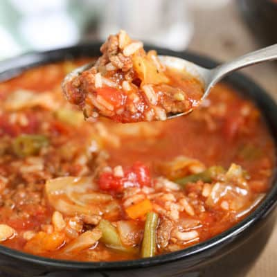 cabbage roll soup in a a bowl and on a spoon