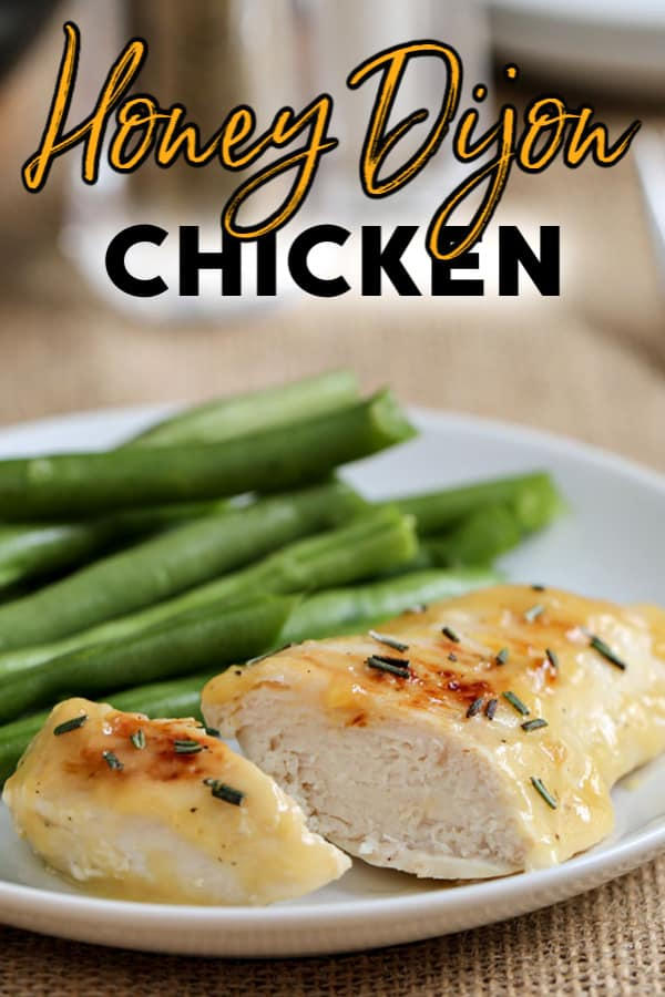 chicken dinner on a plate with green beans