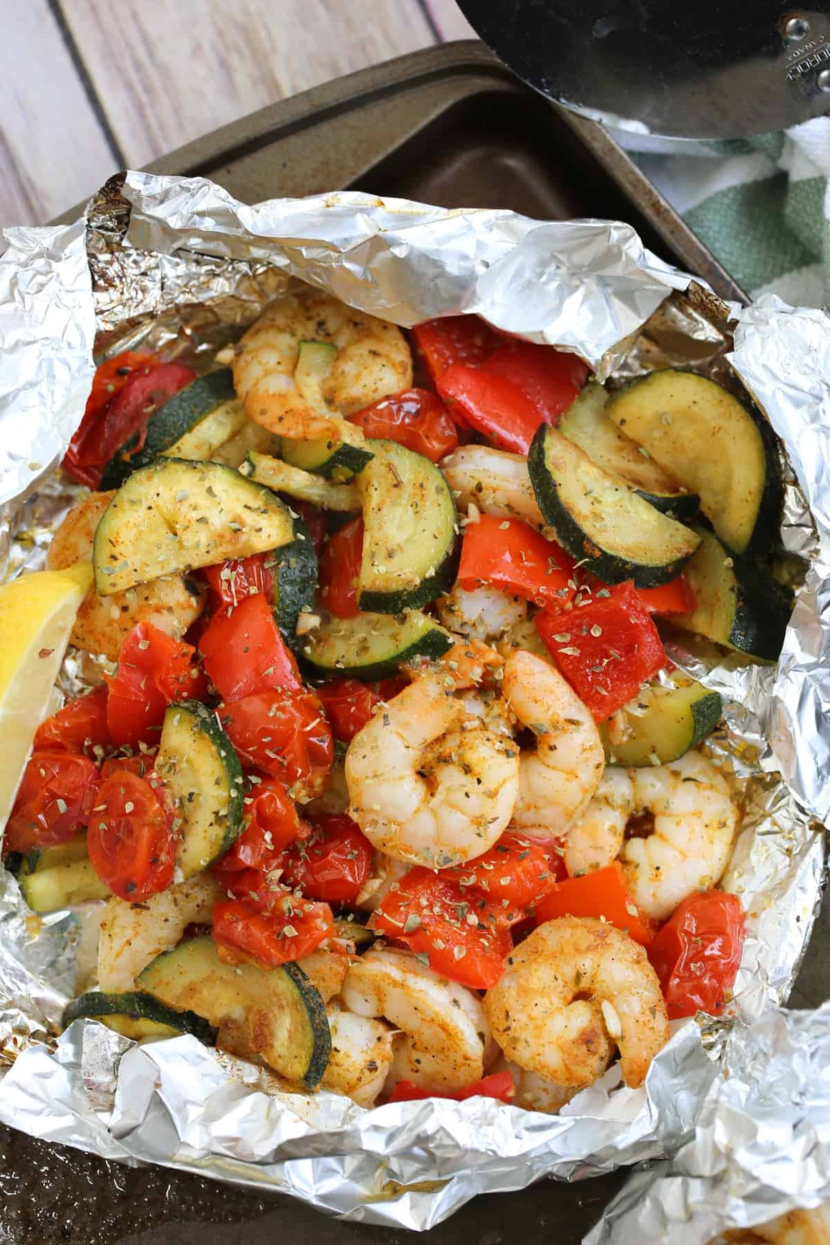 shrimp and summer vegetables in a foil package