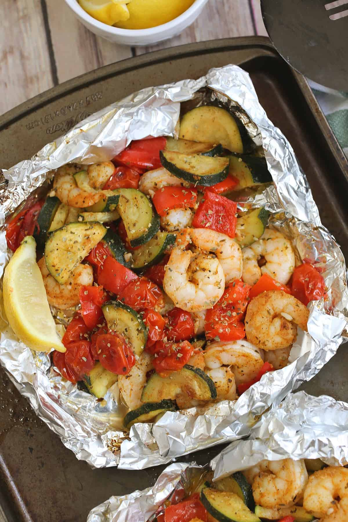 spiced shrimp and vegetables in a foil package
