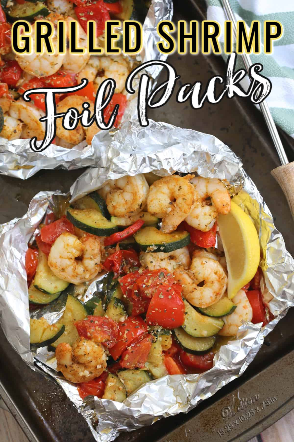 shrimp and vegetables in foil on a sheet
