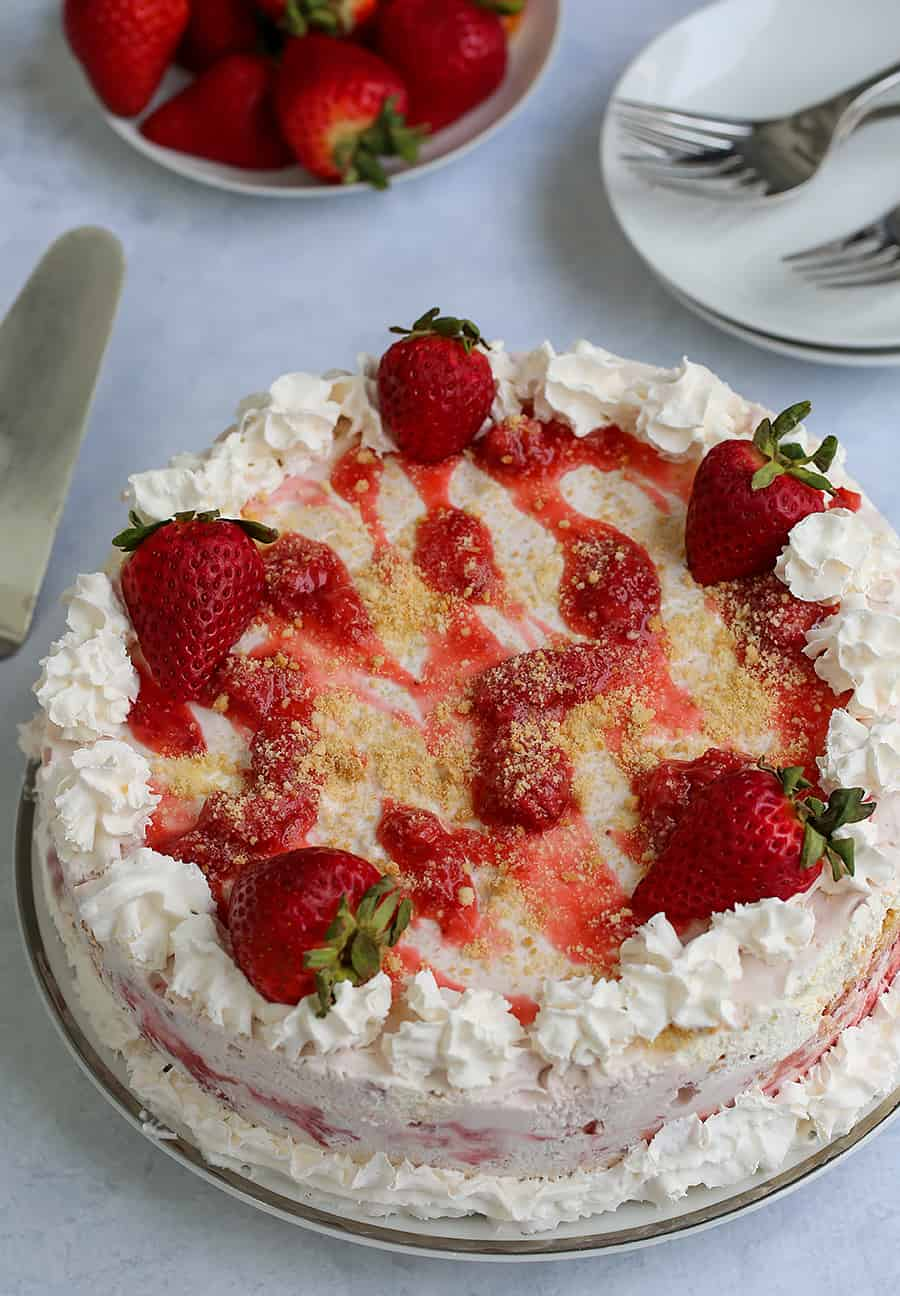 whole strawberry ice cream cake on a table