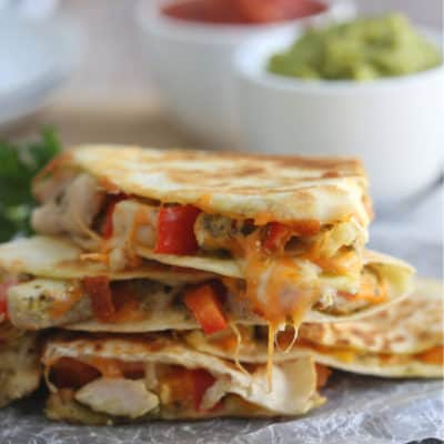 stack of chicken quesadillas on a table