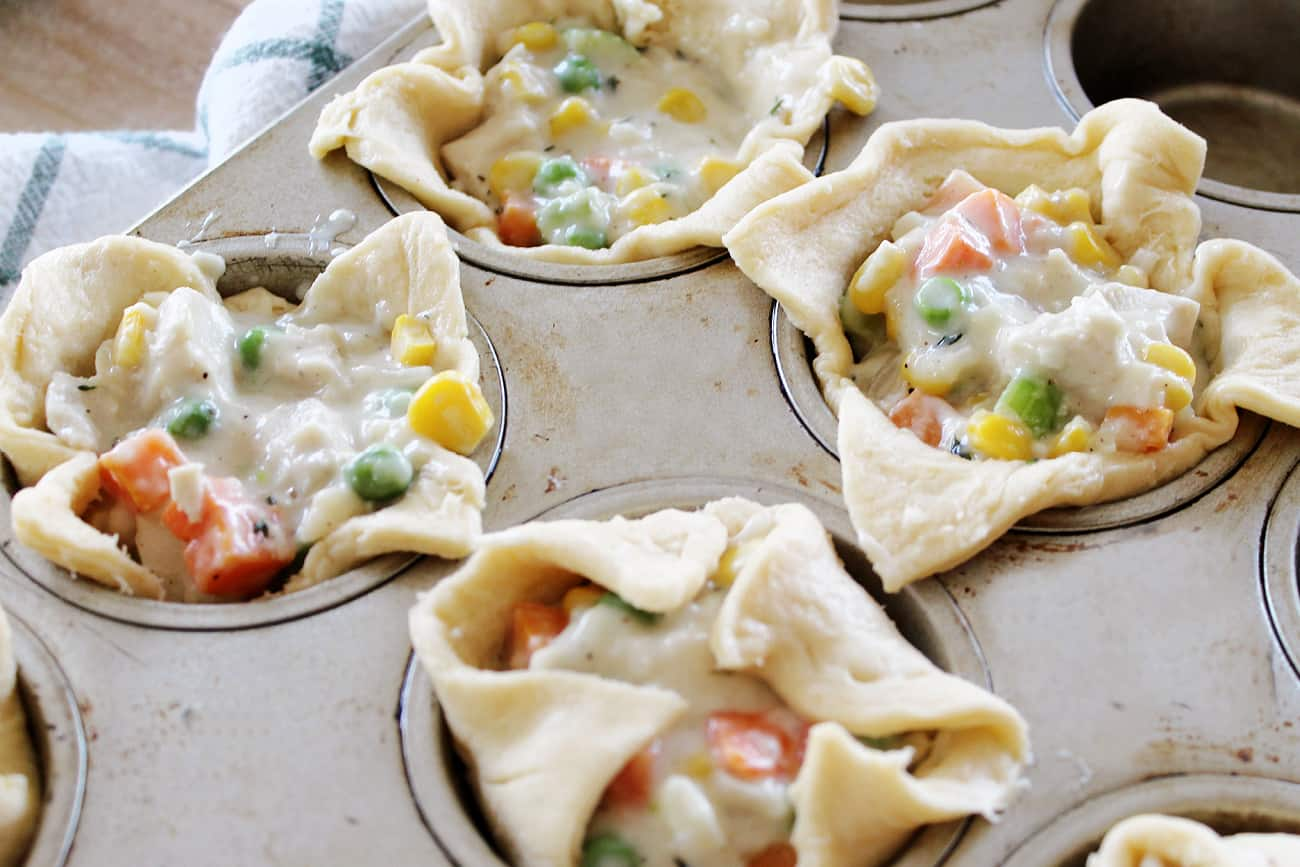 uncooked chicken pot pies in muffin tins