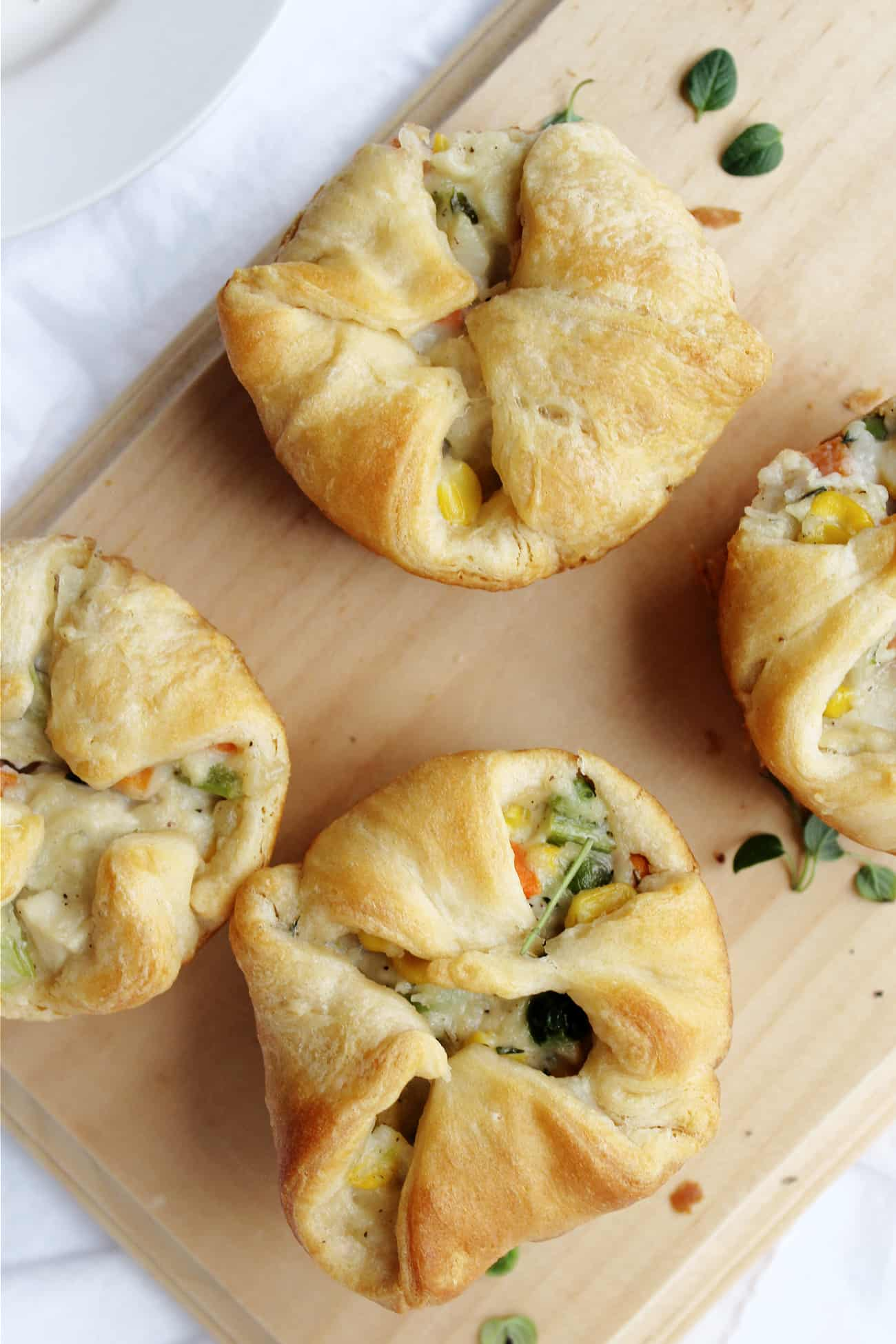 individual chicken pot pies on a cutting board