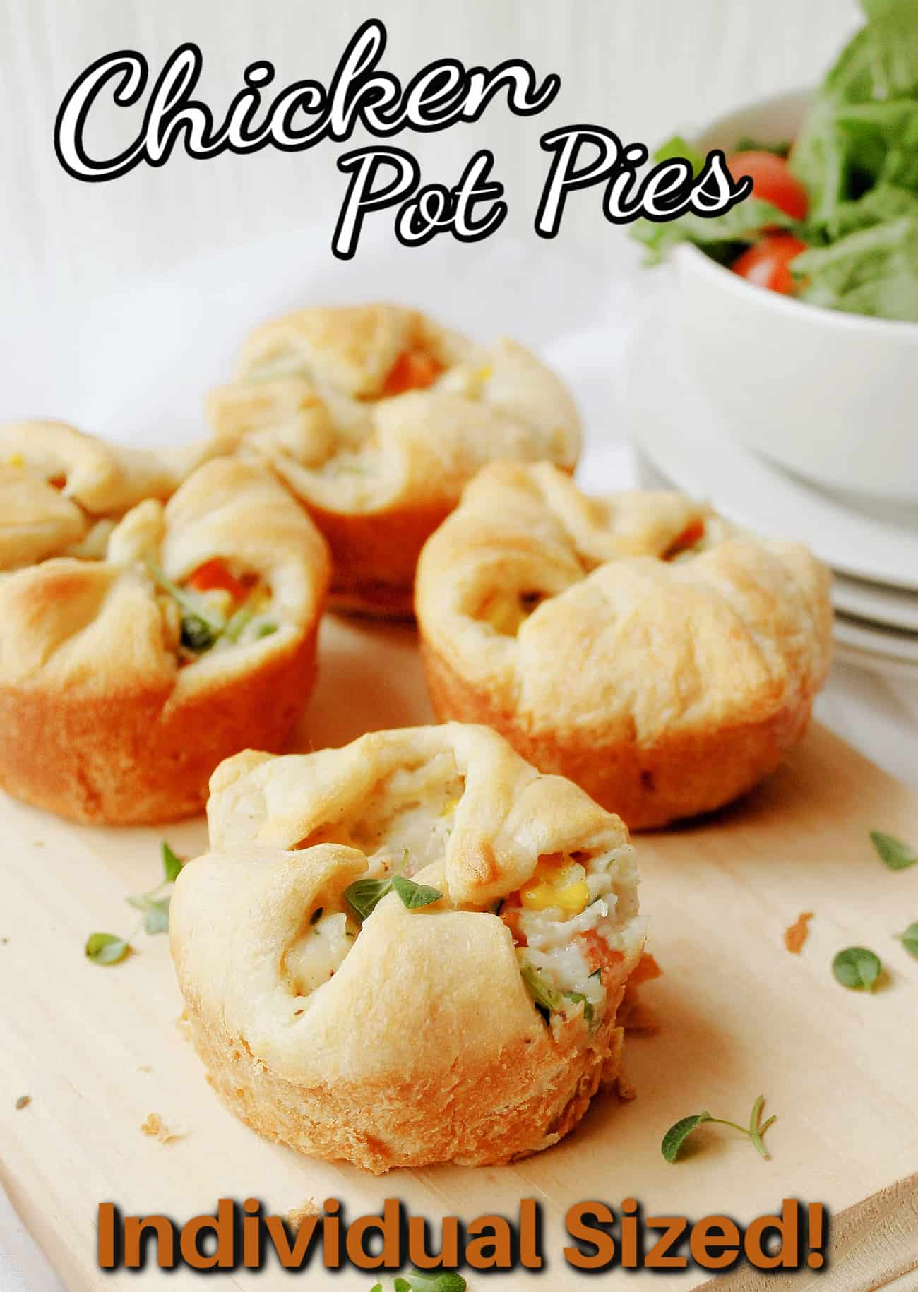 mini chicken pot pies on a cutting board with text