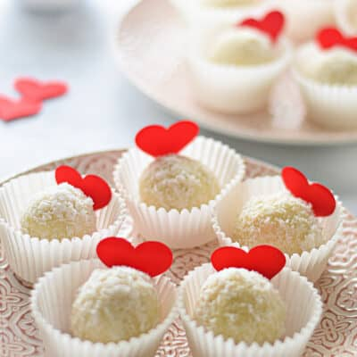white chocolate and coconut truffles on a plate for valentine's day