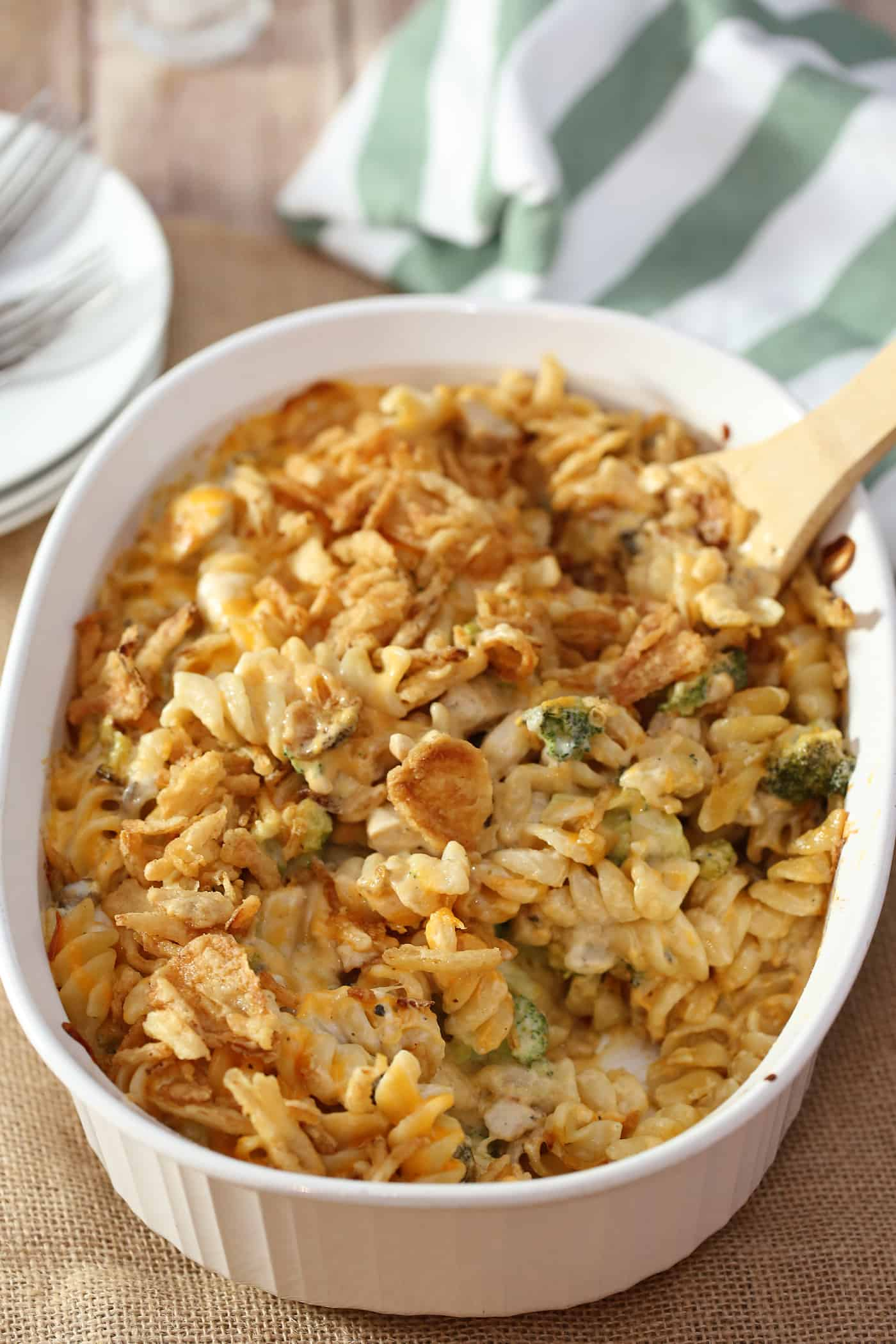chicken noodle casserole in a dish with wooden spoon