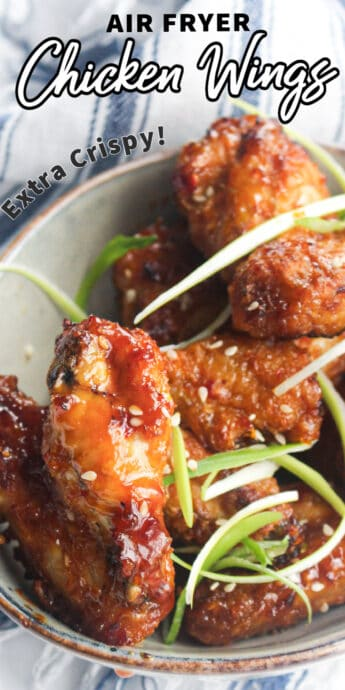 chicken wings in a bowl with text