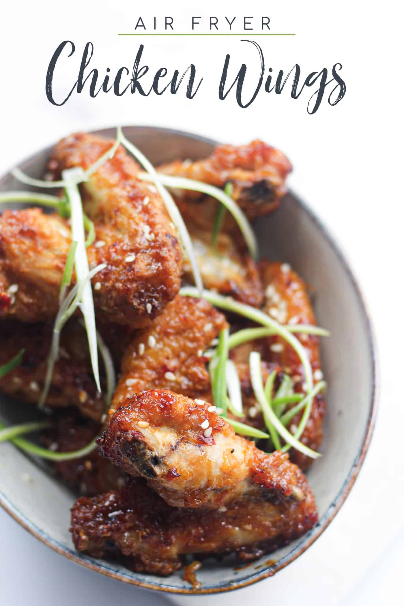 air fryer chicken wings in a bowl with text