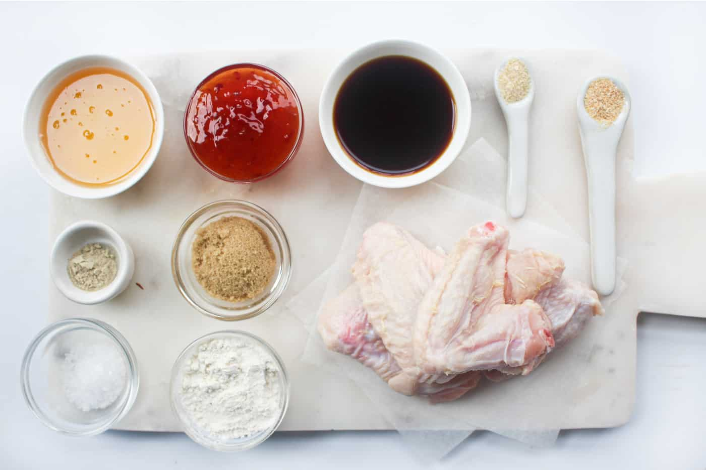 ingredients to make air fryer chicken wings on a table