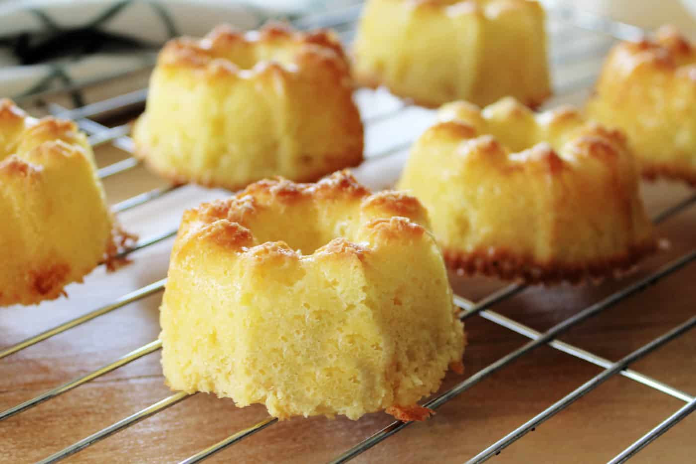 mini bundt cakes cooling on a wore rack
