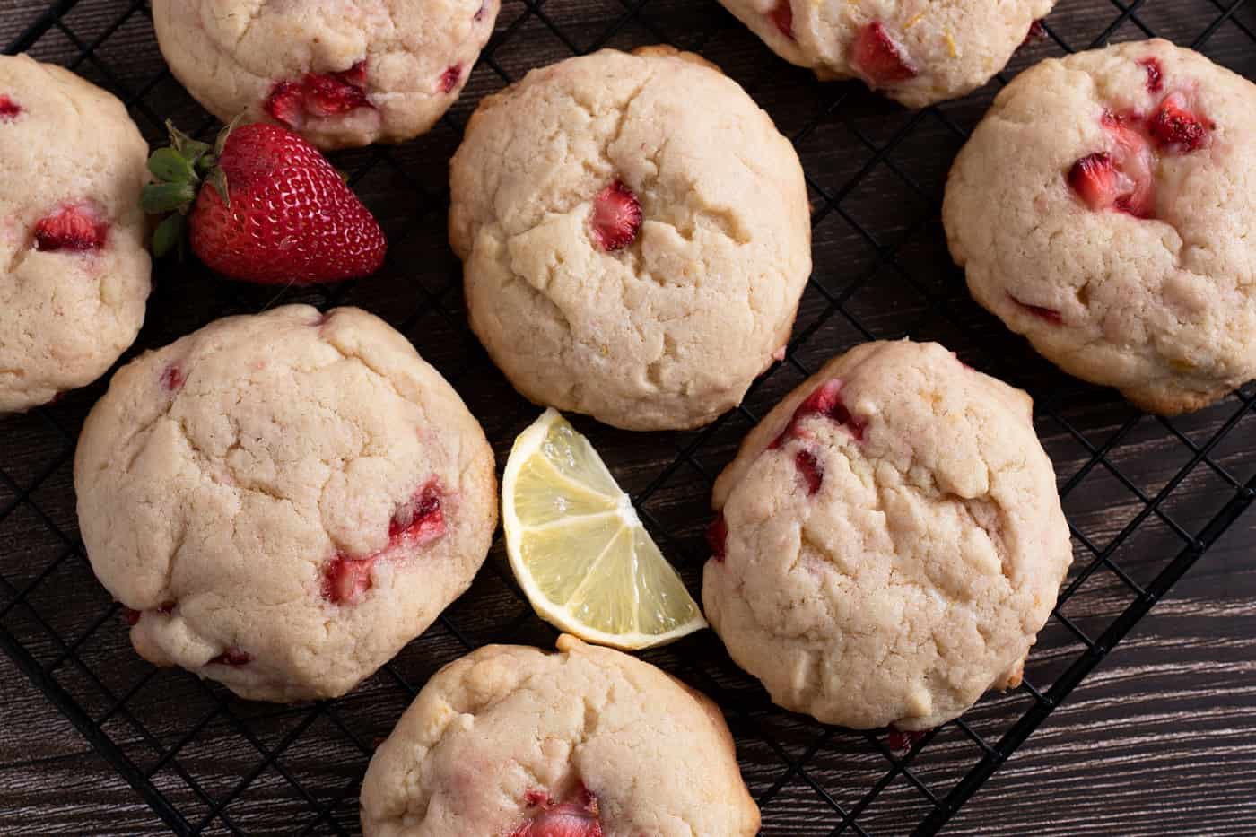 strawberry lemonade cream cheese cookies on a black cooling rack