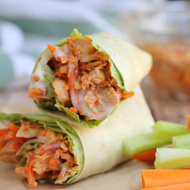 chicken wraps on brown paper with fresh vegetable strips