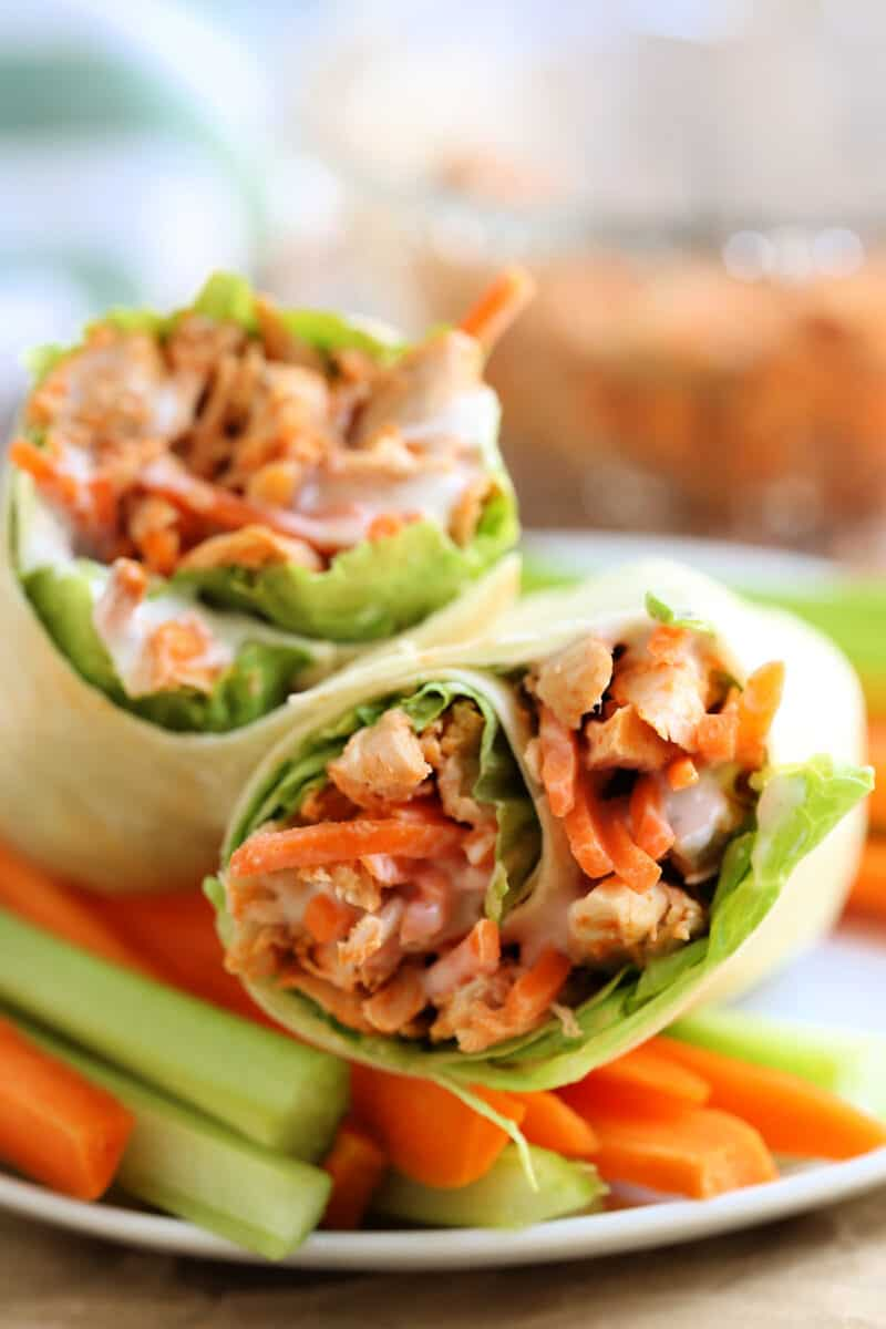 two wraps on a plate with vegetables