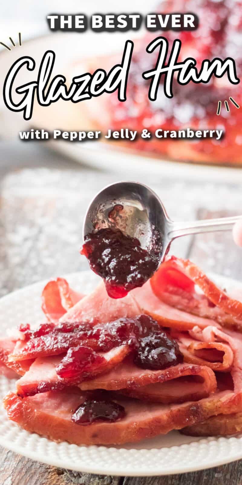 slices of ham on plate with craberry glaze sauce with text