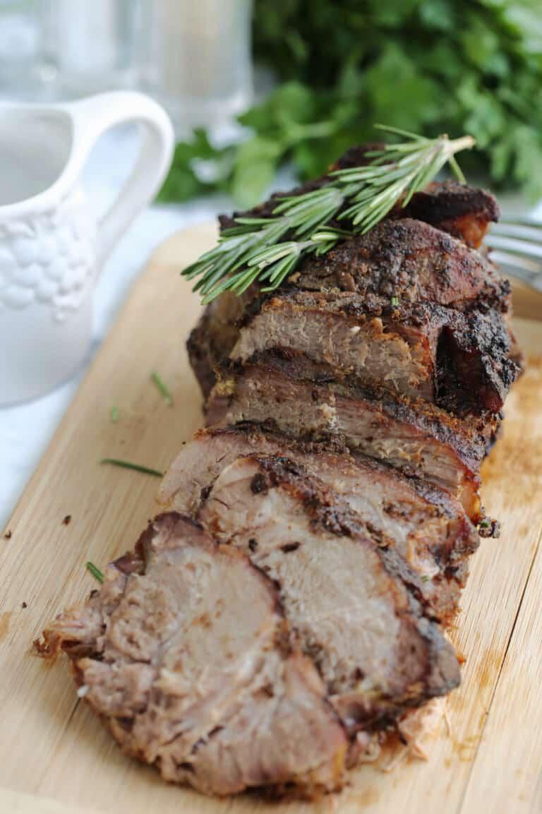 pork roast sliced onto a cutting board